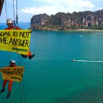 "Krabi, Thailand. Greenpeace climbing activists hangs banner with a message of ""STOP COAL (or COAL IS NOT THE ANSWER) at Rairay beach, admonishing government stop deceptive energy crisis discourse to go to new coal power plant. Photo by Athit Perawongmetha/Greenpeace."